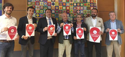 Representantes de UPA Madrid, Mercamadrid y Asomafrut, en la presentación de la campaña de apoyo al producto de proximidad.